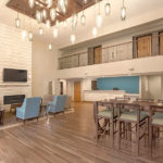 lobby area seating with fire place and front desk